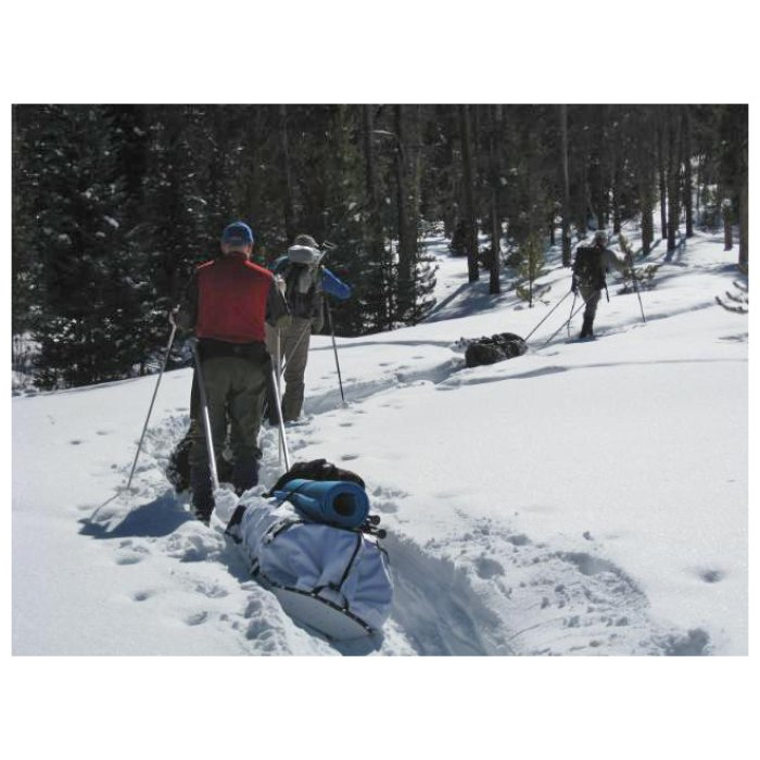 Backcountry Sleds Group of People Using Sleds in Foot Deep Snow