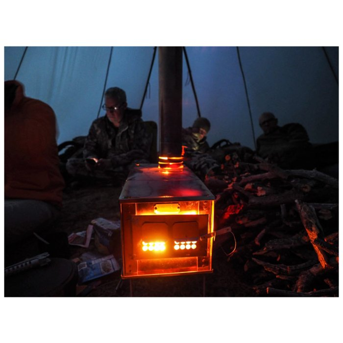 Box Stoves (Stainless Steel) Being Used at Night Lighting and Heating Up the Whole Tent with People Inside