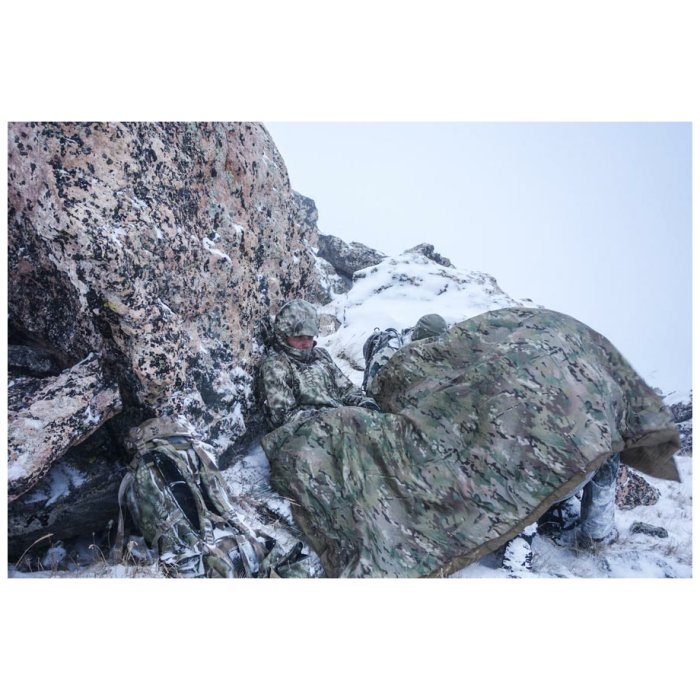 Woobie-Doobie - Man Sleeping on a Cold Mountain with Rocks and Snows with his Multicam Woobie Doobie