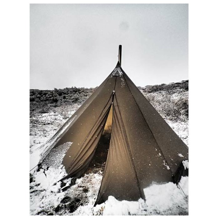 12 Man Tipi Dramatic Photo in the Middle of the Snow