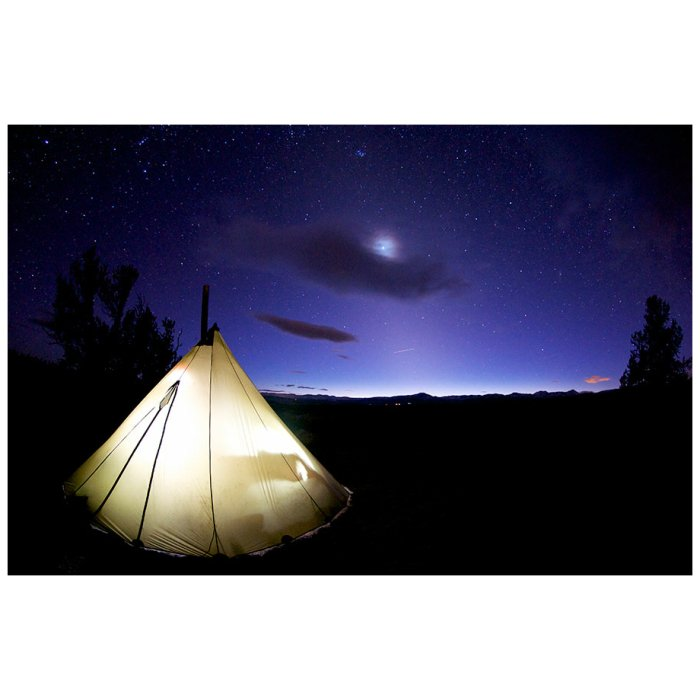 8 Man Tipi At Night with Stars in the sky visible and light inside of tent