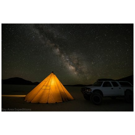 8 Man Tipi at night with stars visible and truck with tent light up