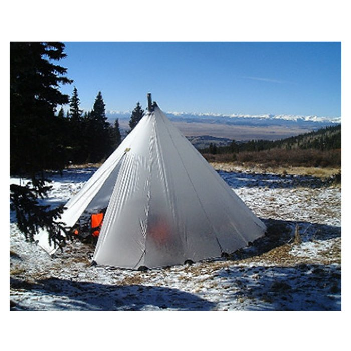 8 Man Tipi during the day with snow on ground and pine trees visible