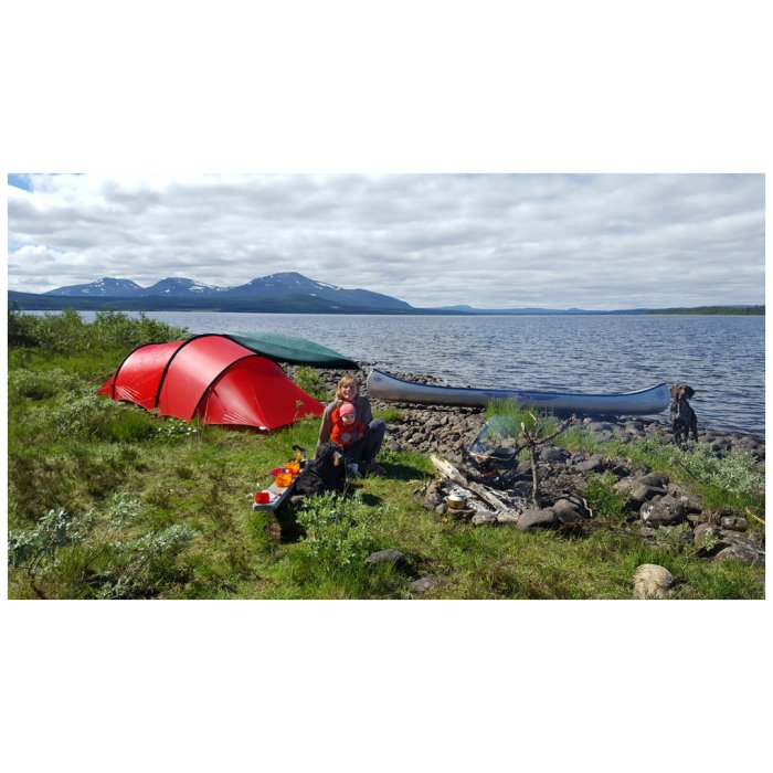 Hilleberg Anjan 2 GT Red with a Mom and Her Baby in her Hands Near a lake or Ocean and a Kayak