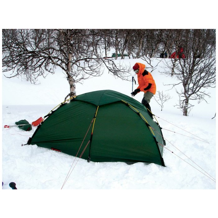 Hilleberg Soulo Sand Photo of Tent in the Middle of the Snow with a Person Visible