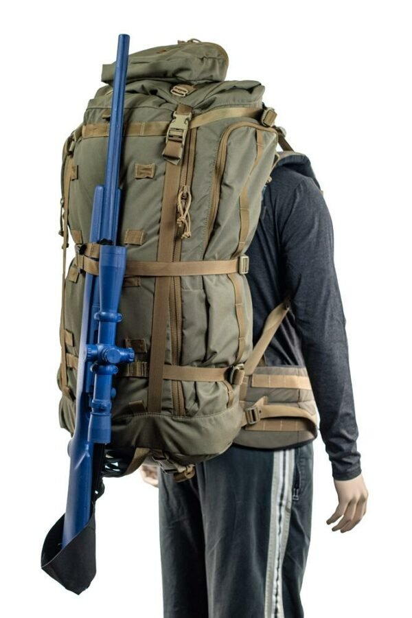 Hoodlum (6,500ci - 106L Bag only) Diagonal Back Photo of Ranger Green Color with Rifle Attached While Being Worn on Mannequin