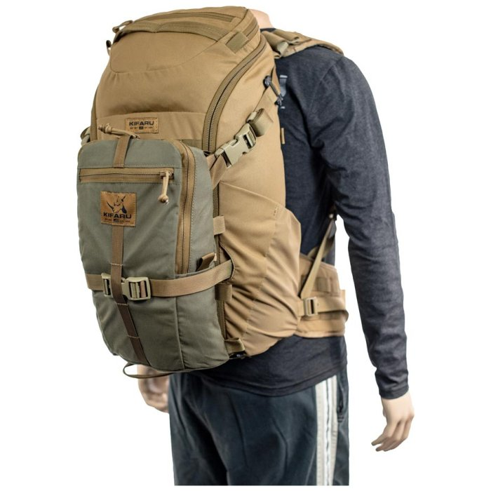 Kifaru International Shape Charge (2,050 ci - 33.5 liters) Diagonal Back Photo of Coyote Brown Color with Green Small Bag Attachment