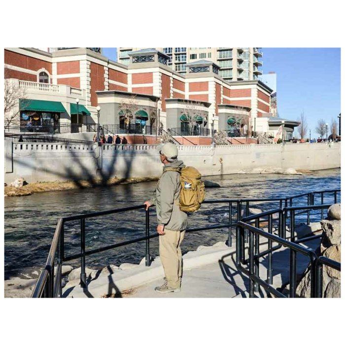 Kifaru International Urban Zippy (1,500ci - 24.58Liters) Photo of Coyote Brown Color Being Worn by Person in Tourist Area Near Water