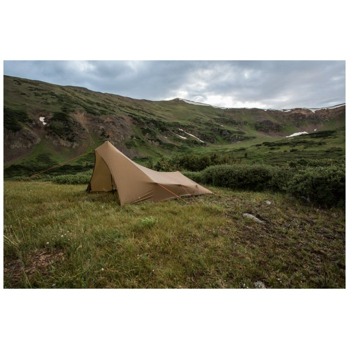 SuperTarp photo from side with mountains and green fields visible